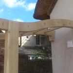 Green oak rose arch mortice and tenon rails