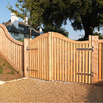 Cedar driveway gates with curved top